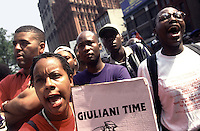New York, NY - 29 August 1997 - Day of Outrage - Haitian community marches from Grand Army Plaza to City Hall to protest police beating and sodomy of Abner Louima. Police were daid to say &quot;it's Giuliani Time&quot; as they brutalized Louima in the bathroom of the 70th Precinct.<br /> <br /> 020128-SWR01.jpg