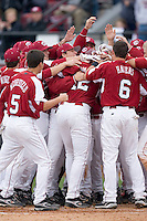 Justin Smoak (12) of the South Carolina Gamecocks is mobbed by his teammates at home plate following his 2-run home run versus the East Carolina Pirates at Sarge Frye Field in Columbia, SC, Sunday, February 24, 2008.