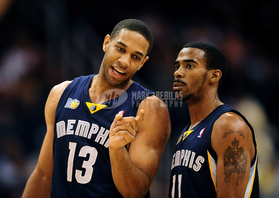 Dec. 8, 2010; Phoenix, AZ, USA; Memphis Grizzlies guard (13) Xavier Henry and guard (11) Mike Conley against the Phoenix Suns at the US Airways Center. Memphis defeated Phoenix 104-98 in overtime. Mandatory Credit: Mark J. Rebilas-