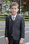 Glen Rooney at first communion in Holy Family church.<br /> Picture www.newsfile.ie