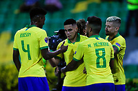ARMENIA, COLOMBIA - JANUARY 19: Brazil's Paulinho (C) celebrates a goal with his teammate Antony during their CONMEBOL Pre-Olympic soccer game against Peru at Centenario Stadium on January 19, 2020 in Armenia, Colombia. (Photo by Daniel Munoz/VIEW press/Getty Images)