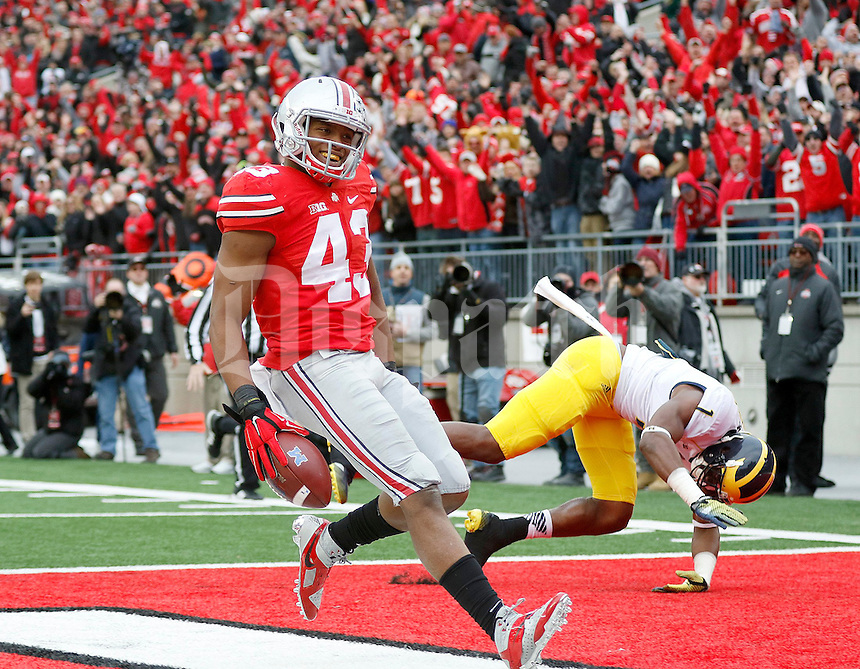 Ohio State Buckeyes linebacker Darron Lee (43) smiles after returning a fumble for a touchdown during the fourth quarter of the NCAA football game against Michigan at Ohio Stadium on Saturday, November 29, 2014. (Columbus Dispatch photo by Jonathan Quilter)