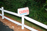 Campaign signs adorn a fence near the parking area before Republican presidential candidate Dr. Ben Carson speaks at a town hall campaign stop at a meeting of the Windham Republican Town Committee at the Castleton Banquet and Conference Center in Windham, New Hampshire.
