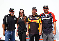 May 31, 2013; Englishtown, NJ, USA: NHRA funny car drivers (L-R) Tony Pedregon, Alexis DeJoria, Del Worsham and Cruz Pedregon during qualifying for the Summer Nationals at Raceway Park. Mandatory Credit: Mark J. Rebilas-