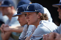 Ethan Schmidt (16) of the Xavier Musketeers stands in the dugout against during the game against the Penn State Nittany Lions at Coleman Field at the USA Baseball National Training Center on February 25, 2017 in Cary, North Carolina. The Musketeers defeated the Nittany Lions 10-4 in game one of a double header. (Brian Westerholt/Four Seam Images)