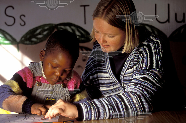© Giacomo Pirozzi / Panos Pictures..LESOTHO..European girl working in a primary school in her gap year.