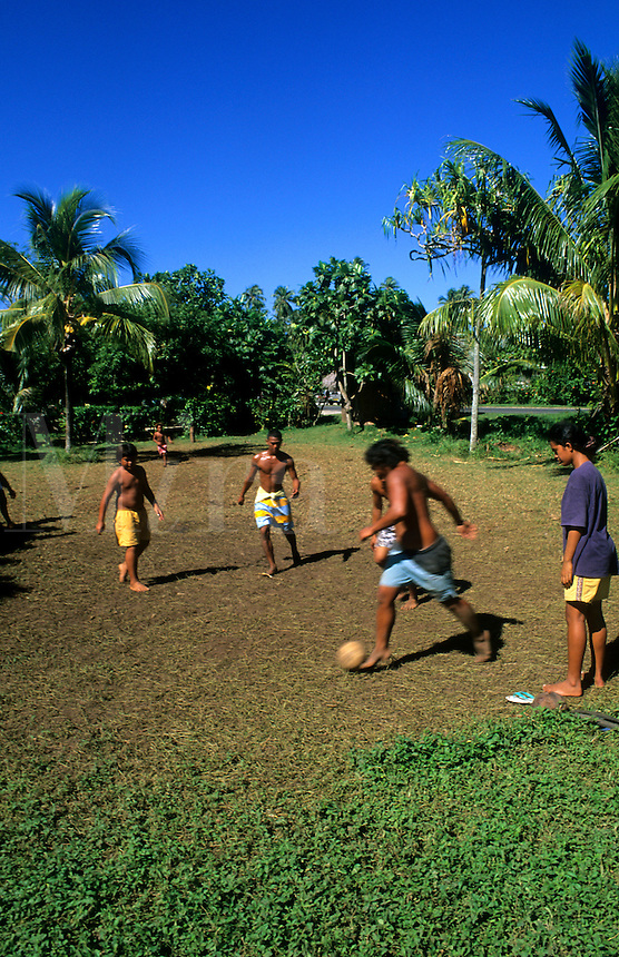 Children playing soccer in Heapiti, Tahiti, French Polynesia