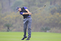 Ross Fisher (ENG) plays his 3rd shot on the 3rd hole during Thursday's Round 1 of the 2014 BMW Masters held at Lake Malaren, Shanghai, China 30th October 2014.<br /> Picture: Eoin Clarke www.golffile.ie