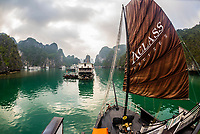 Aclass Cruises Legend ship anchored in Halong Bay, North Vietnam. The bay features 3,000  limestone and dolomite karsts and islets in various shapes and sizes sprinkled over 1,500 square kilometers. It offers a wonderland of karst topography. It is a UNESCO World Heritage Site.