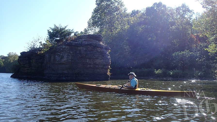 NWA Democrat-Gazette/FLIP PUTTHOFF<br />Warren Cunningham of Springdale glides across Lincoln Lake Oct. 13 2017, among rocks and bluffs that ring the waterway. The small lake north of Lincoln is a haven for paddling, hiking, mountain biking, rock climbing, fishing and birding.