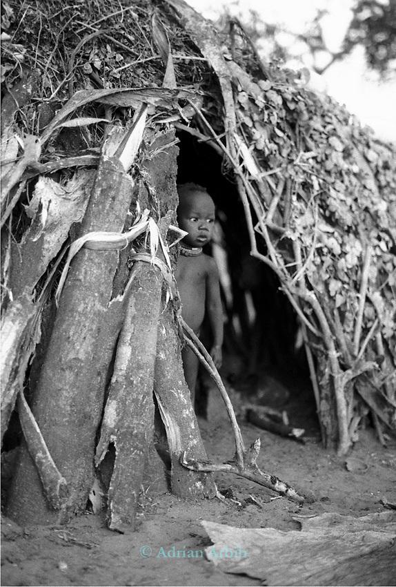 Turkana child in a traditional village nr Kakuma, Northern Kenya.