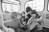 The Playbus, Wester Hailes, Scotland, 1979.  John Walmsley was Photographer in Residence at the Education Centre for three weeks in 1979.  The Education Centre was, at the time, Scotland's largest purpose built community High School open all day every day for all ages from primary to adults.  The town of Wester Hailes, a few miles to the south west of Edinburgh, was built in the early 1970s mostly of blocks of flats and high rises.