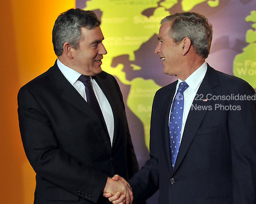 Washington, D.C. - November 15, 2008 -- United States President George W. Bush welcomes Prime Minister Gordon Brown of the United Kingdom to the Summit on Financial Markets and the World Economy leaders to the National Building Museum in Washington, D.C. on Saturday, November 15, 2008..Credit: Ron Sachs / Pool via CNP
