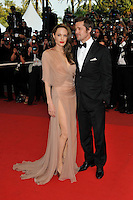 ANGELINA JOLIE &amp; BRAD PITT<br /> The &quot;Inglourious Basterds&quot; Premiere at the Grand Theatre Lumiere during the 62nd Annual Cannes Film Festival, Cannes, France.<br /> May 20th, 2009<br /> full length black tuxedo suit cream beige brown pink dress sheer long wrap couple open toe shoes slit split low cut neckline profile thigh hand in pocket<br /> CAP/PL<br /> &copy;Phil Loftus/Capital Pictures /MediaPunch ***NORTH AND SOUTH AMERICAS ONLY***