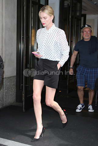 NEW YORK, NY - MAY 4: Charlize Theron seen leaving her hotel while checking her mobile phone in New York City on May 04, 2018. Credit: RW/MediaPunch