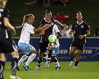 Abby Wambach #20 of the Washington Freedom pushes away from Katie Chapman #17 of the Chicago Red Star during a WPS match at the Maryland Soccerplex, in Boyds Maryland on June 12 2010. The game ended in a 2-2 tie.