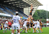 James Cannon rises high to win lineout ball. Pre-season friendly match, between London Wasps and London Irish on August 24, 2013 at Adams Park in High Wycombe, England. Photo by: Patrick Khachfe / Onside Images