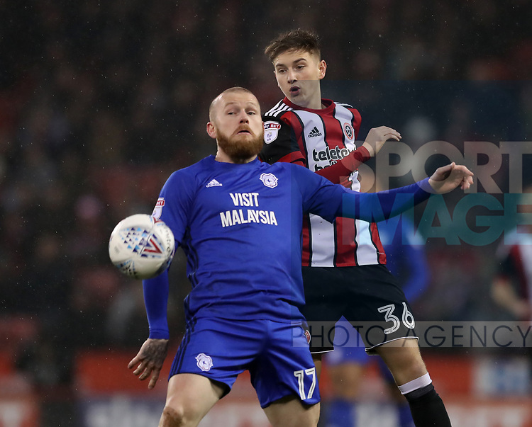 David Brooks of Sheffield Utd and Aron Gunnarsson of Cardiff City during the Championship match at Bramall Lane Stadium, Sheffield. Picture date 02nd April, 2018. Picture credit should read: Simon Bellis/Sportimage