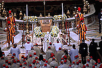 "Pope Benedict XVI kneels before the coffin of his predecessor Pope John Paul II in St. Peter's Basilica in the Vatican following his beatification. Pope Benedict XVI hailed John Paul II's ""strength of a titan"" in defending Christianity against ""a tide which appeared irreversible"" in a homily in Saint Peter's Square.May 1, 2011,"