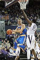 JAN 1, 2016:  UCLA's #20 Bryce Alford tries to pass the ball away at the last second as he runs into traffic under the basket against Washington.  Washington defeated #25 ranked UCLA 96-93 in double overtime at Alaska Airlines Arena in Seattle, WA.