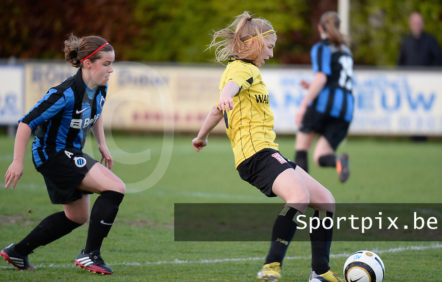 20140502 - VARSENARE , BELGIUM : duel pictured between Brugge's Celine Vandekerkhove  (l) and Lierse's Merel Groenen (r) during the soccer match between the women teams of Club Brugge Vrouwen  and WD Lierse SK  , on the 26th matchday of the BeNeleague competition on Friday 2 May 2014 in Varsenare .  PHOTO DAVID CATRY