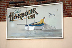 Sign showing fisherman at The Harbour Inn, Southwold harbour, Suffolk, England