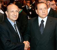 Il Presidente del Consiglio Silvio Berlusconi stringe la mano al presidente  di Confesercenti Marco Venturi, a destra, poco prima dell'inizio dell'Assemblea annuale, a Roma, 25 giugno 2008..UPDATE IMAGES PRESS/Riccardo De Luca
