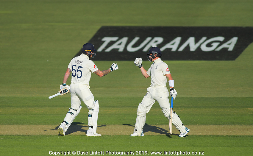 England's Ben Stokes celebrates his 50 with Ollie Pope during day one of the international cricket 1st test match between NZ Black Caps and England at Bay Oval in Mount Maunganui, New Zealand on Thursday, 21 November 2019. Photo: Dave Lintott / lintottphoto.co.nz