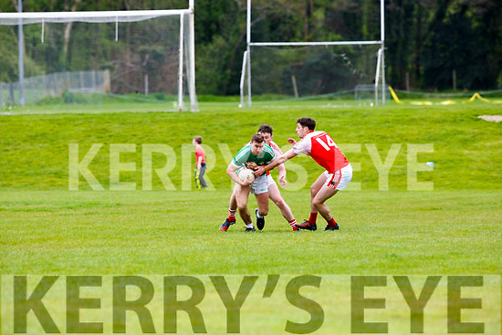 Legion James O'Donoghue is tackled by Dingle duo Paul Geaney and Tomas O'Suileabhain during their Club Championship clash in Killarney on Sunday