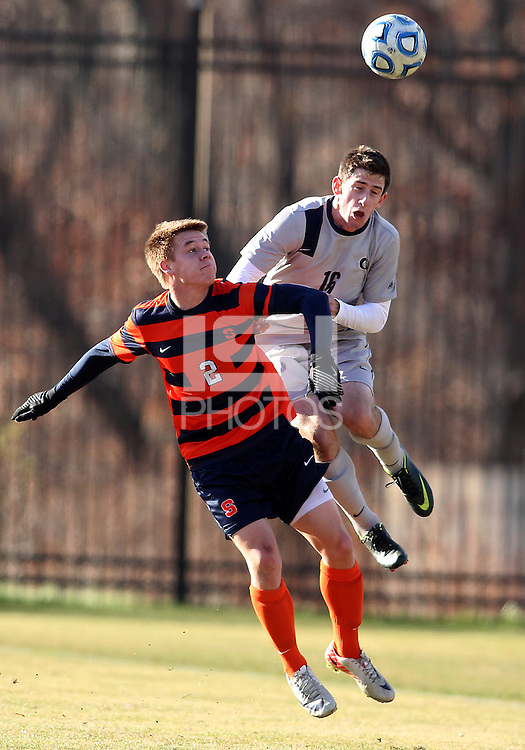 WASHINGTON, DC - NOVEMBER 25, 2012: Jimmy Nealis (16) of Georgetown University heads over Jordan Vale (2) of Syracuse University during an NCAA championship third round match at North Kehoe field, in Georgetown, Washington DC on November 25. Georgetown won 2-1 after overtime and penalty kicks.