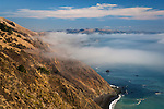 Steep and rugged hills and fog over the Sonoma coast; California