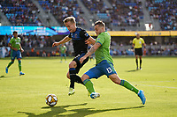 SAN JOSE, CA - SEPTEMBER 29: Tommy Thompson #22 of the San Jose Earthquakes and Jordan Morris #13 of the Seattle Sounders FC battle for the ball during a Major League Soccer (MLS) match between the San Jose Earthquakes and the Seattle Sounders on September 29, 2019 at Avaya Stadium in San Jose, California.