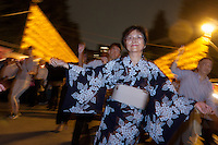 Dancer perform traditional Bon Odori dances during  the Mitama matsuri or festival of remembrance at the controversial Yasukuni Shrine in Chiyoda, Tokyo, Japan. Tuesday, July 13th 2010