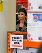 Alexandria, VA - December 15, 2009 -- Senior Advisor Valerie Jarrett looks on as United States President Barack Obama (not pictured) discusses the economic impact of energy saving home retrofits with labor, manufacturing, and small business leaders during remarks at a Northern Virginia Home Depot store in Alexandria, Virginia on Tuesday, December 15, 2009..Credit: Ron Sachs - Pool via CNP
