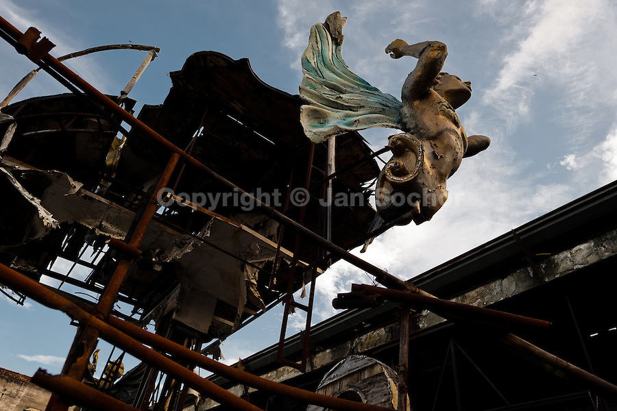 A dismantled and damaged carnival float abandoned on the work yard behind the Samba school workshops in Rio de Janeiro, Brazil, 15 February 2012. Most of the large carnival floats, colorful designs and fancy costumes are dismantled, cut into pieces or simply thrown into garbage right after the last day of the Carnival. The low-tech materials as fiberglass, plastic or polystyrene, which most of the of the carnival floats and statues are made of, are stocked in the warehouses to be recycled and used in the future parades. However, there is no use for some of the statues so they slowly fall apart into pieces forming a ?Carnival cemetery? in the industrial yards around the port of Rio de Janeiro.