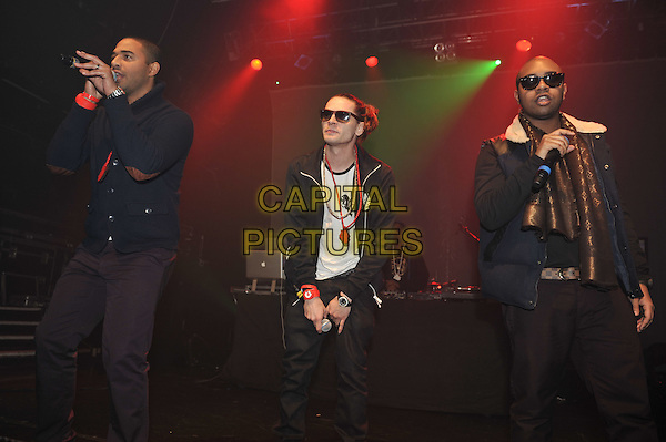 Roll Deep.performing at the SBTV Christmas Party, Koko, Camden, London, England..21st December 2011.on stage in concert live gig performance half length jacket gold scarf black singing sunglasses shades jeans denim white full 3/4.CAP/MAR.© Martin Harris/Capital Pictures.