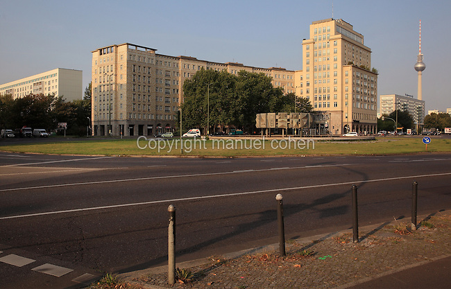 Buildings along Karl Marx Allee, a monumental socialist boulevard built 1952-65 by the former East German state, with the Fernsehturm or Television Tower in the distance, Berlin, Germany. Picture by Manuel Cohen