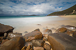 Misty water over the rocks at Zenith Beach, Shoal Bay, Port Stephens, NSW, Australia