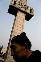 "A cross-shaped tower marked with the dates of the Nanjing Massacre stands high above the Assembly Ground outside the Memorial Hall of the Nanjing Massacre in Nanjing, China, on Thursday, Dec. 13, 2007.  After two years of renovations, the Memorial Hall of the Nanjing Massacre reopened to the public on Dec. 13, 2007, the 70th anniversary of the 6-week massacre by Japanese troops that started Dec. 13, 1937 and claimed more than 300,000 lives.  The commemoration comes amid renewed controversy about the accuracy of historical accounts of the massacre.  The massacre is also known as ""The Rape of Nanking."""