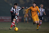 Zak Mills of Grimsby Town is closely marked by Ryan Bird of Newport County during the Sky Bet League Two match between Newport County and Grimsby Town at Rodney Parade, Newport, Wales, UK. Tuesday 14 February 2017