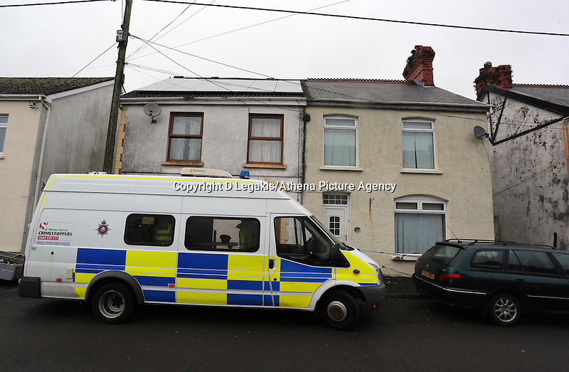 """Pictured: Police still outside the family home (in beige) in Pontyberem, Carmarthenshire, west Wales. Wednesday 19 February 2014 <br /> Re: The parents of a six-day-old baby who died at a house in Carmarthenshire where a dog was later seized have paid tribute to a """"dearly loved daughter"""".<br /> Eliza-Mae Mullane from Pontyberem was flown to hospital in Cardiff on Tuesday but doctors were unable to save her.<br /> Her parents Sharon John and Patrick Mullane, said they would cherish the short time they had with her, adding """"she will always be in our hearts.""""<br /> The family's pet Alaskan Malamute Nisha has been seized by police.<br /> The tribute continued: """"Even though she was an important part of our family for such a short period of time, Eliza-Mae will always be in our hearts and thoughts and we will cherish the little time we were able to share with her.<br /> """"She was a dearly loved daughter, sister, grand-daughter and niece."""
