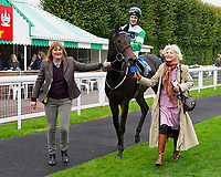Connections lead Caiya, ridden by Charles Bishop and trained by Eve Johnson Houghton into the winners enclosure after winning The Byerley Stud EBF Fillies' Novice Stakes  during Bathwick Tyres Reduced Admission Race Day at Salisbury Racecourse on 9th October 2017