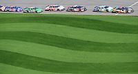Sept. 27, 2008; Kansas City, KS, USA; NASCAR Nationwide Series driver Mike Bliss (1) leads a group of drivers onto pit road during the Kansas Lottery 300 at Kansas Speedway. Mandatory Credit: Mark J. Rebilas-