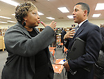 """The Gazette President of the Wimbrook Area Civic Association Pat O'Neal of Clinton speaks with Lt. Governor Anthony Brown about crime at the """"Listen and Learn""""  Town Hall at Crossland High School in Temple Hills on Tuesday evening."""