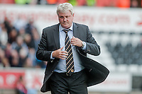 SWANSEA, WALES - APRIL 04: Manager of Hull City, Steve Bruce  walks back to the dugout during the Premier League match between Swansea City and Hull City at Liberty Stadium on April 04, 2015 in Swansea, Wales.  (photo by Athena Pictures)