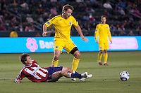 Chivas USA forward Justin Braun (17) tackles Chad Marshall (14) of the Columbus Crew. Chivas USA and Columbus Crew played to a 0-0 tie at Home Depot Center stadium in Carson, California on  April  9, 2011....