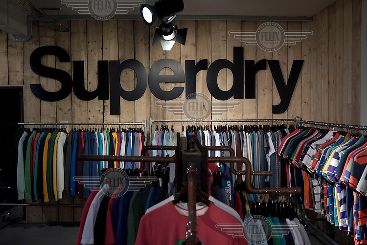 Clothes hang on rails at the Superdry clothing brand headquarters in Cheltenham.