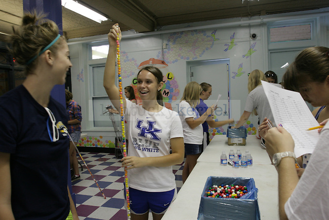 Pre-communication disorders freshman Alaina Bauer, left, and undeclared sophomore Amanda Slone helped fill tubes with gumballs that will make up a mural for children in the Explorium of Lexington as part of UK FUSION, an annual community service project, held at different sites around the city with a record 1384 students volunteering on Monday, Aug. 22, 2011, in Lexington, Ky. Photo by Becca Clemons | STAFF