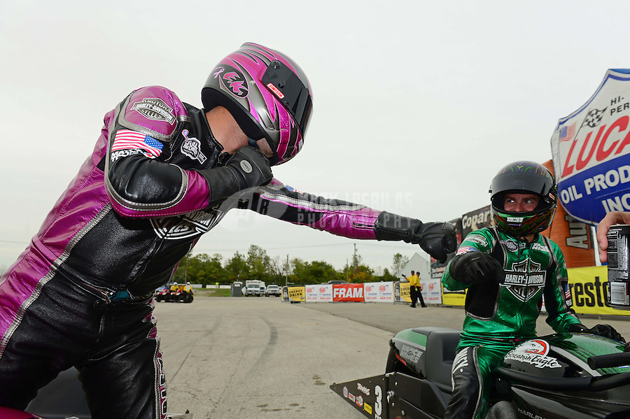 Sept. 30, 2012; Madison, IL, USA: NHRA pro stock motorcycle rider Eddie Krawiec (left) celebrates with teammate Andrew Hines after winning the Midwest Nationals at Gateway Motorsports Park. Mandatory Credit: Mark J. Rebilas-