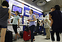 July 17, 2010 - Tokyo, Japan - Commuters walk past information board, at Ueno station in Tokyo, Japan, on July 17, 2010. The new high-speed railway line was launched that day linking Nippori Station and Airport Terminal 2 Station in 36 minutes, 15 minutes faster than on the old Skyliner.